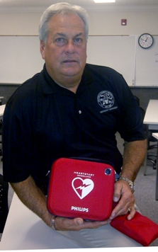 Whitfield County EMA Director Claude Craig displays AED that was recently purchased for the agency's mobile command vehicle- web